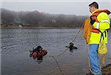Diver being pulled in by rope