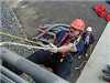 Rescue Member climbing the side of a building