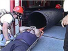 Rescue member with rope in a pipe