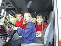 Kids sitting in the firetruck